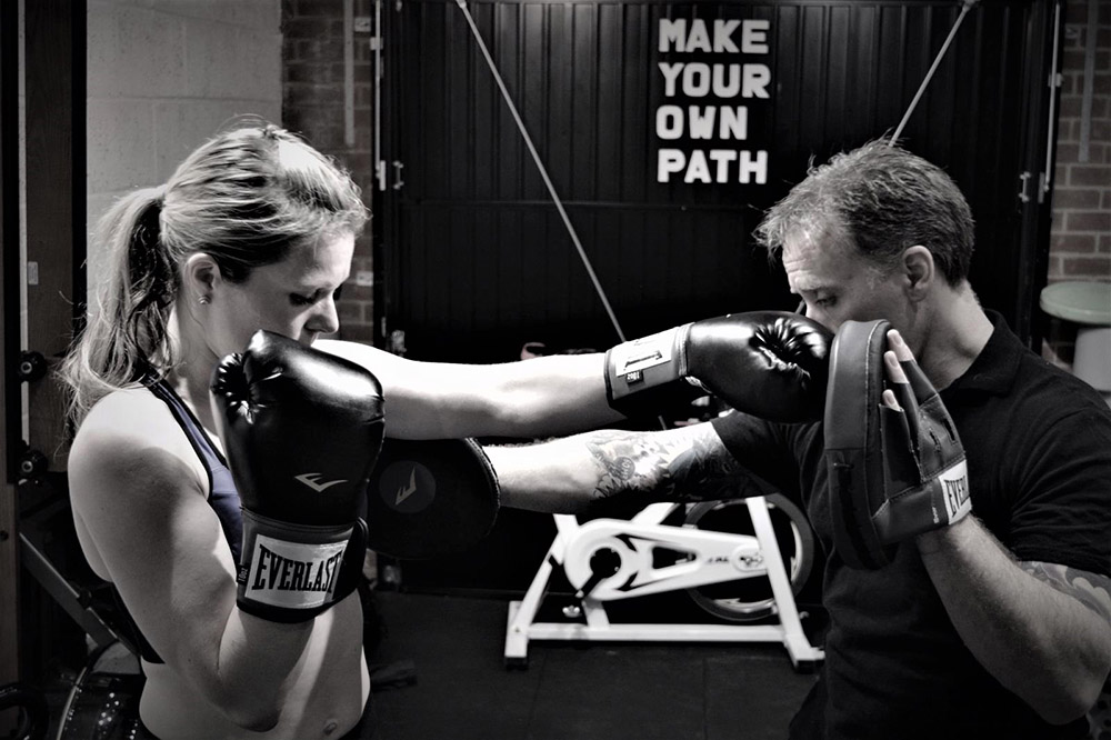 Client sparring with personal trainer at Simply Fitt Gym