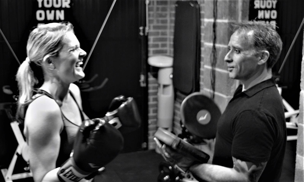 James O'driscoll laughing with personal training client
