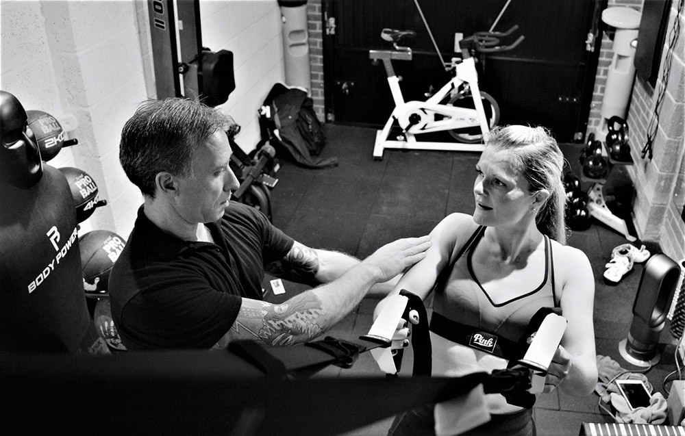 Personal trainer working with client at Simply Fitt Gym